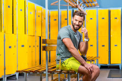 Man with phone in the gym Royalty Free Stock Image