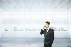 Man on phone in hangar Stock Photo