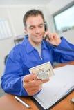 Man on phone holding plug socket royalty free stock photos