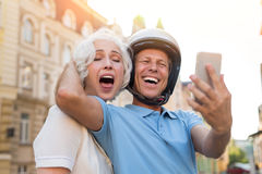 Man with phone is laughing. Royalty Free Stock Image