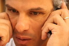 Man at phone, meditative Royalty Free Stock Photography