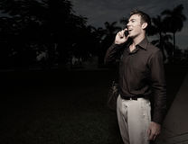 Man on the phone at night Stock Photos