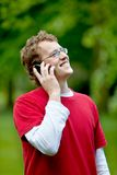 Man on the phone outdoors Stock Images