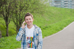 Man with phone in the park Royalty Free Stock Images