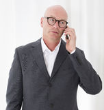 Man on the phone. Portrait of a bald-headed man being on the phone Stock Photo