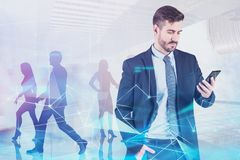 Man with phone and team, network connection stock image