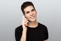 Man on a phone. Teenager making a telephone call Stock Photos