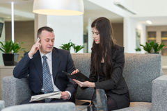 A man with phone and women talking Royalty Free Stock Photography