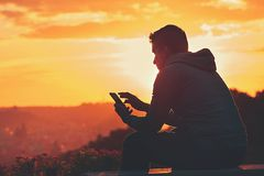 Man with phone. Young man with phone at the sunrise Royalty Free Stock Photos