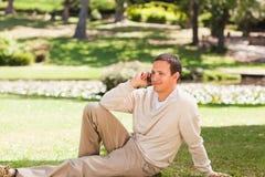 Man phoning outside Stock Image