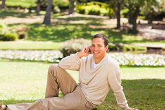 Man phoning in the park Royalty Free Stock Images