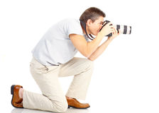 Man with photo camera. Handsome man with photo camera. Isolated over white background Stock Photo