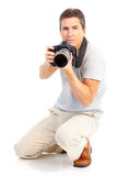 Man with photo camera. Handsome man with photo camera. Isolated over white background Stock Photography