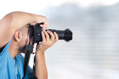 Man with photo camera. Close up photo of  man with photo camera Royalty Free Stock Photography