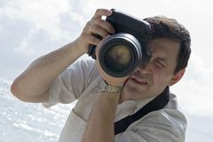 Man with photo camera Stock Photography