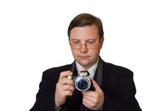 Man with photo camera. Isolated on white background stock photography