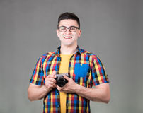 Man with photo camera isolated on gray background Stock Photos