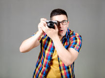 Man with photo camera isolated on gray background Royalty Free Stock Image