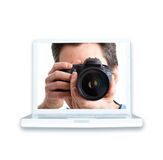 Man with photo camera and laptop Stock Images