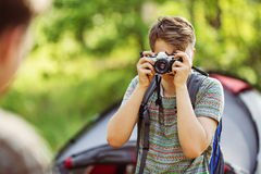 Man with photo camera outdoor with forest nature on background Stock Images