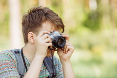 Man with photo camera outdoor with summer forest on background Royalty Free Stock Photography