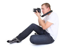 Man with photo camera sitting Royalty Free Stock Photography