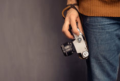 Man with photo camera. Unrecognizable man is holding a vintage photo camera, space for text Royalty Free Stock Images