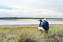 The man photograph sitting on the nature Stock Photography