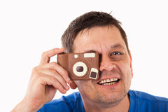 A man photographed with a camera made of chocolate. Isolated Royalty Free Stock Image