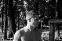 Man photographed in street workout session. Looking to start another exercise. Photo was taken in early morning, around 6am in city park Dudova forest. Black royalty free stock photography