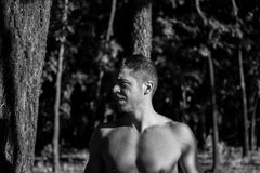 Man photographed in street workout session. Male working out in the forest early in the morning. Black and white photo stock photos