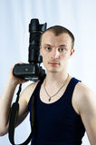 Man photographer. Man keeps in hand camera Royalty Free Stock Image