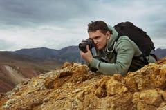 Man photographer camera mountains concept Stock Photography