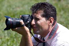 Man photographer with camera outdoors Royalty Free Stock Photo