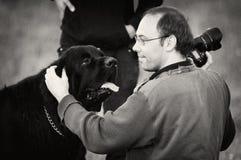 Man photographer with dog Royalty Free Stock Image