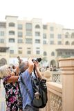 Man photographer in Dubai . photographer with big backpack and camera taking photo . Travel Lifestyle stock photos