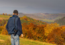 Man photographer in the mountains forest. Stock Photo