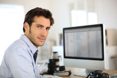 Man photographer at office working Royalty Free Stock Photos