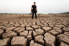 Man photographer stand on drought texture with head skull Royalty Free Stock Photos