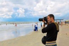 Man photographer takes shot Royalty Free Stock Images