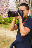 Man photographer taking pictures in nature Stock Photography