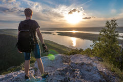 The man is a photographer on top of a mountain Royalty Free Stock Photos