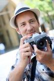 Man photographer using retro camera Royalty Free Stock Image