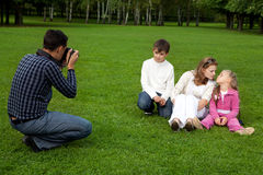 Man photographes his family outdoors Stock Photos