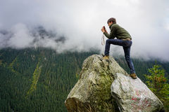 Man photographing beautiful scenery on Transfagarasan, Romania royalty free stock photography
