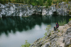 Man photographing a beautiful view from the cliff Stock Image