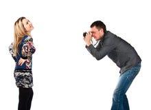 A man photographing a beautiful young woman Stock Photos