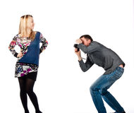 A man photographing a beautiful young woman Stock Photo