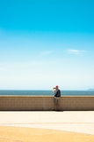 Man photographing blue sky and seascape Stock Photography