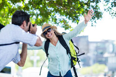 Man photographing cheerful woman Royalty Free Stock Photography